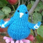 Cooey by Granny Anne in Suffolk, UK having a 'peck' at the Apple Tree!